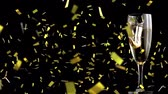 querflöte : Animation of piece of gold falling into a full champagne glass with golden confetti falling during New Year Eve celebrations on black background Videos