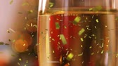 querflöte : Animation of a full champagne glass with golden confetti falling during New Year Eve celebrations Videos