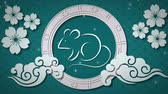 rat : Animation of a white rat in a spinning wheel with turning white flowers, moving cloud shapes and falling snow on a blue background 4k