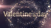 結婚式 : Animation of the words Valentines Day written in gold letters with spinning gold light particles on blue background