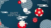 rat : Animation of the words Happy New Year, written in white letters with moving red, white and yellow flowers and patterns on a blue background