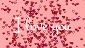 te amo : Animation of the words I Love You written in white text, with red and pink heart shaped and outline heart shaped balloons floating up on a pale pink background Archivo de Video