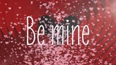 se movendo para cima : Animation of the words Be Mine written in white letters, with tiny translucent pink hearts flying up and red hearts appearing on black background. Celebrating Valentines Day.