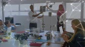 učitel : Animation of a mixed race male and a female engineer wearing a hijab presenting an eco friendly solar panel to their students, network of connections moving in the foreground. Environment and eco friendly car engineering, Dostupné videozáznamy