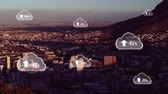rede social : Animation of white clouds with percent increasing from zero to one hundred over cityscape with clouds on blue sky in the background. Global networking cloud computing in modern world concept combination image. Stock Footage