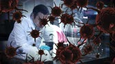 datum : Animation of purple macro corona virus spreading and floating with a male scientist working in laboratory with microscope and data processing in the background. Global health warning scare spreading infections concept digital composite.