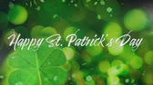 trevo : Animation of the words Happy St. Patricks Day written in white letters, with multiple green shamrock clover leaves moving on green background. Celebration of Irish culture concept digitally generated image.