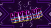 Animation of the words Level Up written in multi coloured letters written over purple kaleidoscope of stars moving in hypnotic motion in the background. Video computer game screen and digital interface concept digitally generated image.