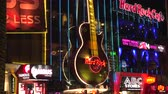 duro : 4K ES Las Vegas CIRCA 2016 -  A neon guitar outside the Hard Rock Cafe on the Las Vegas Strip at night. Filmed using Sony FS-5 w Zeiss 28mm Prime Lens in 4K UHD Native Resolution at 30P.