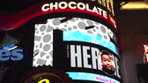 noc : 4K ES: Hersheys Chocolate World along the Brooklyn Bridge at New York New York brings tourists to colorful mega digital signs and billboards. Circa 2016 Filmed using Sony FS-5 w Zeiss 28mm Prime Lens in 4K UHD Native Resolution at 30P.