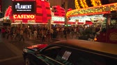 fãs : 4K ES: Polished black stretch limousine waits for pedestrian to pass on Fremont Street, Las Vegas. Sony FS5 4k UHD 30p Native Resolution Stock Footage