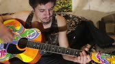 gipsy : Guy plays guitar hippie style
