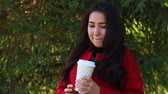 vinte anos : Girl in a red coat drinking coffee Vídeos