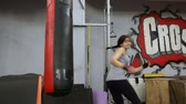 bo : Woman kicks bag intense kickboxing muay thai training amateur beginner martial arts class