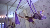peão : Practice of anti gravity fly yoga with hammock. Stock Footage
