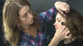 кинозвезды : Woman making beauty and make up treatment in a saloon. Concept about beauty and people Стоковые видеозаписи