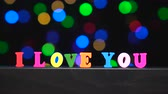eu te amo : Colorful words i love you from multi-colored wooden letters in front of abstract blurred lights bokeh background