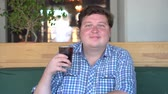 fast ice : Fat man holding a glass of soft drink cola carbonated, sitting in cafe. Beverage and healthy.