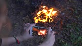 ハーモニー : The woman shot bright bonfire with the smartphone (camping video)