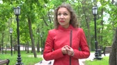 görme : Portrait of the attractive young worried girl in red leather jacket Stok Video