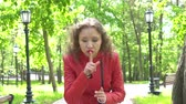 görme : Portrait of Young Woman in Red Leather Jacket Gesturing Silence, Finger on Lips