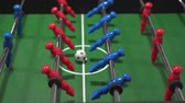 trest : Foosball known as table soccer, blue and red players in football kicker game