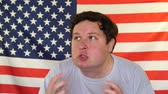 serio : Portrait of young angry man on the background of an USA flag