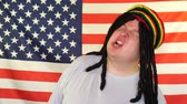 raszta : Rastaman Having Fun with His Dreadlocks on the Background of an USA Flag