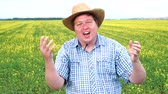 sorpreso : Winner! A dream of the young fat farmer came true. He is very excited, wearing hat, celebrating