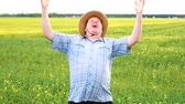 delighted : Portrait of funny farmer. Man going crazy. Raising her hands and shout. Posing on at the field on sunny day