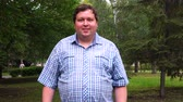 gorditos : Portrait of a happy fat guy in checkered shirt in the park