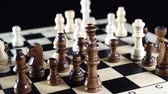 rycerz : Chess board turns slowly around its axis. Close up 4K video. Black background
