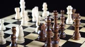 rycerz : Chess figures spread on the chess board. Board makes a hundred eighty degree rotation Wideo