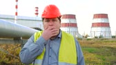 abriu : Worker, engineer, or electrician opened his mouth in surprise or frustration in front of a power station