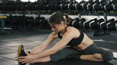 Sportive girl doing stretching