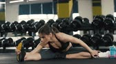 Young girl doing stretching exercises in gym