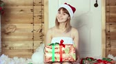 ribbon : girl looking Christmas gifts Stock Footage