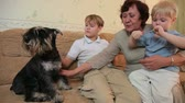 couch : Grandmother with kids and pets at home