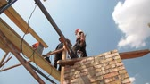 Construction workers on scaffold doing welding work Wideo