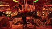 tontura : LONDON, UK - NOVEMBER 30, 2017 Merry go round carousel in London Stock Footage