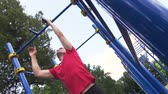 gymnast : Sporty Young Man Doing Pull Ups Exercise.