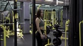 elegáns : Beautiful Young Woman Finished Strength Training In The Gym Stock mozgókép