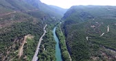 landslide : Aerial view of the bridge and the road over the river Pinios in the green valley of Tempe in Greece