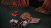 gaming chips : chips and counterfeit money on casino table, playing roulette.