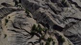 dört : Aerial footage of gray mountains and ravine. Great top view on a canyon with gray mountains. Another planet footage