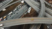 automóveis : Aerial drone flight over road traffic. Moving taxi on the road junction