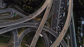 автомагистраль : aerial view of road junction with moving cars. Nice evening footage of road intersection on motorway Стоковые видеозаписи