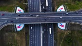 ring road : Aerial view of a motorway. Camera move forward with a view on car interchange. A lot of cars ride on the 10 lanes motorway.