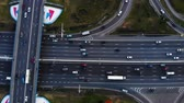 ring road : Aerial view of a motorway. Camera move slow left. A lot of cars ride on the 10 lanes motorway.