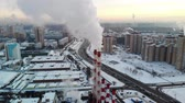 нержавеющая сталь : Aerial view of industrial zone with large red and white pipes with white smoke. Smoke is poured from the factory pipe in contrast to the sun. Pollution of the environment: pipes with smoke.